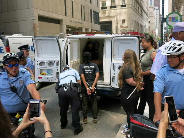 Philadelphia police arrest Sunrise Movement activists in July after they staged a sit-in. The protesters intended to target a Pennsylvania Democratic Party office but had an incorrect address.