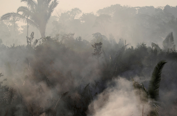 Smoke billows during a fire in an area of the Amazon rainforest near Humaita, Brazil, on Aug. 14.