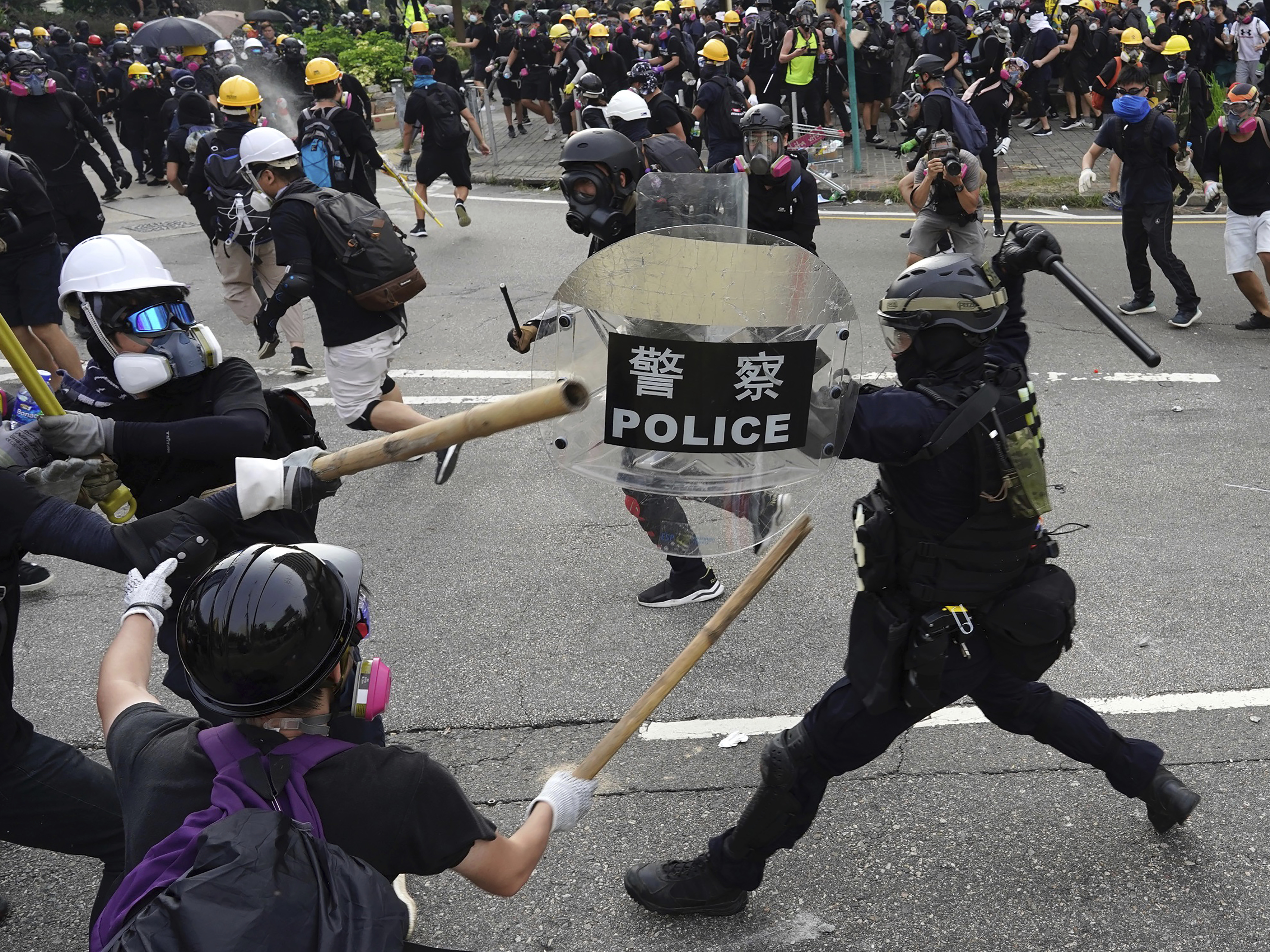 Violence Returns To Hong Kong As Police Fire Tear Gas And Protesters Fight Back