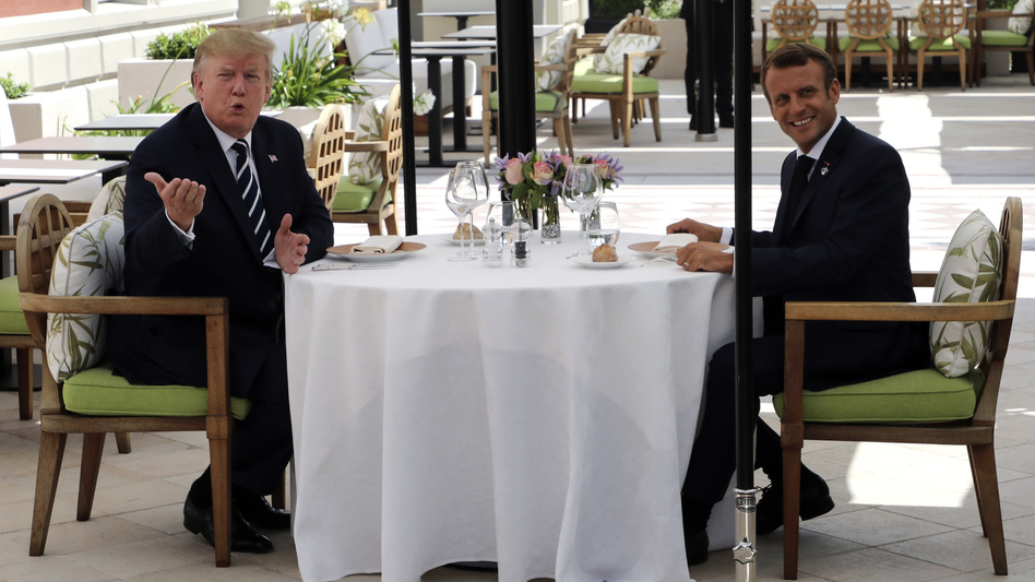 U.S. President Trump has lunch with French President Emmanuel Macron in Biarritz, France. Leaders of some of the world's major economies have arrived in the country for the Group of Seven summit. (Ludovic Marin/AP)