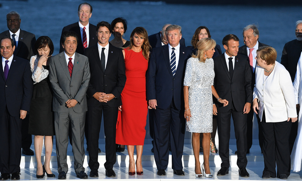 World leaders gather for a group photo at the G-7 summit in Biarritz, France, on Sunday. Summit host and French President Emmanuel Macron and President Trump held a joint news conference on Monday.