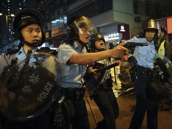 Hong Kong police fire warning shot during night of violent