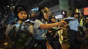 Hong Kong Police Fire Warning Shot During Night Of Violent Clashes With Protesters