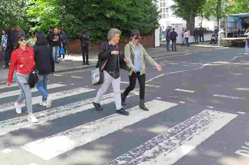 World Cafe Host Talia Schlanger on the iconic Abbey Road crosswalk with Beatles Tour Guide Richard Porter.