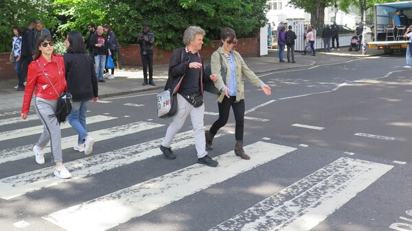 World Cafe Host, Talia Schlanger on the iconic Abbey Road crosswalk with Beatles Tour Guide, Richard Porter.