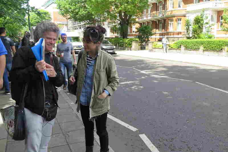 Tour guide Richard Porter sharing Beatles stories with host Talia Schlanger.