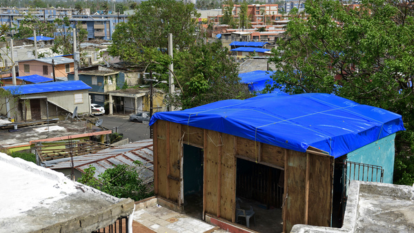 Homes in the Cantera area of San Juan, Puerto Rico are covered with FEMA tarps after Hurricane Maria. The island is now bracing for another major storm.