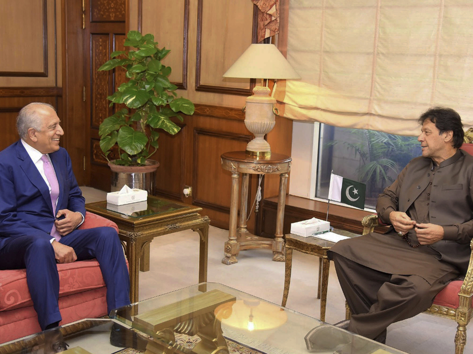 Pakistan's Prime Minister Imran Khan meets U.S. Special Envoy Zalmay Khalilzad (left) in Islamabad on Aug. 1. Khalilzad met Khan ahead of peace talks in Qatar with the Taliban. (Press Information Department via AP)