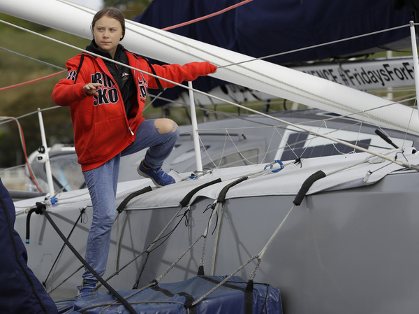 Greta Thunberg climbs onto the emission-free racing yacht Malizia as she prepares to set off for the U.S. from Plymouth, England, to attend a United Nations climate summit. After a two-week journey sailing across the Atlantic Ocean, the 16-year-old Swedish climate activist arrived in New York on Wednesday.