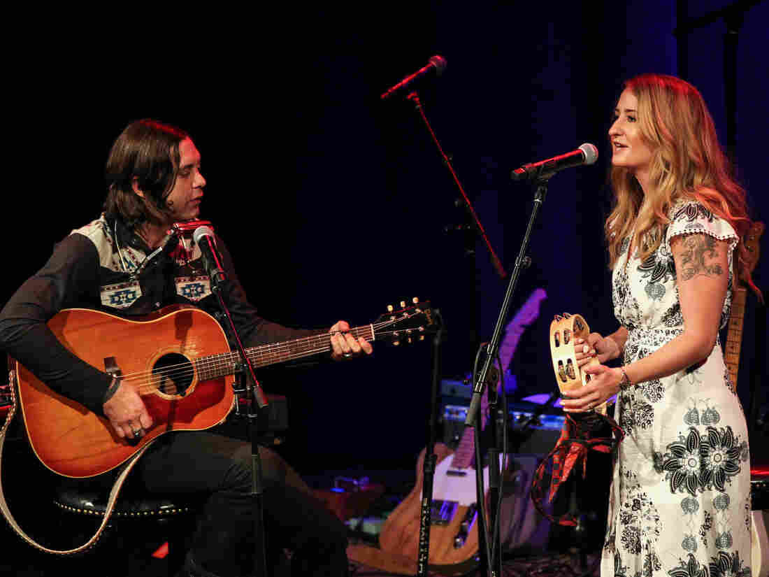 Margo Price and Jeremy Ivey in concert on stage in 2019