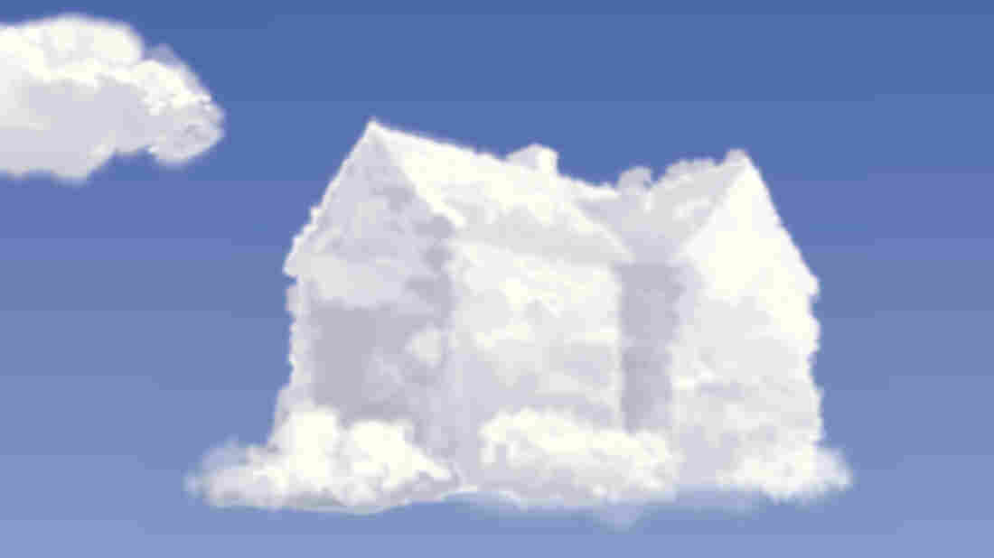 A cloud in the shape of a house floating against a clear blue sky.