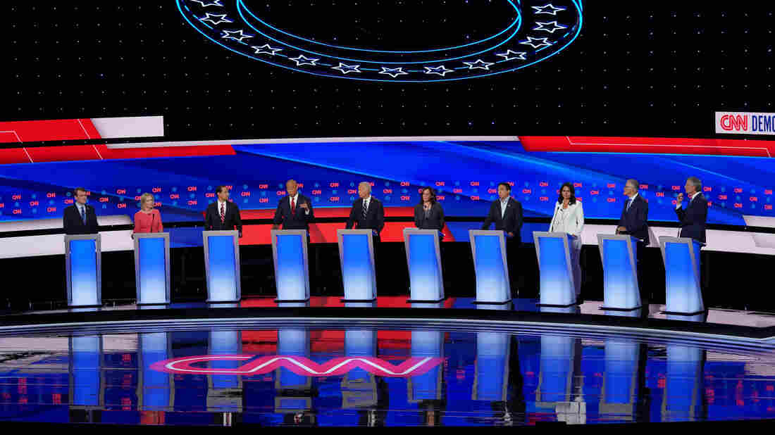 Democratic presidential candidates line up on stage. (Photo by Scott Olson/Getty Images)