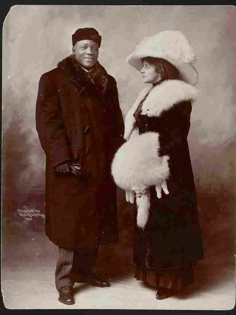 Jack Johnson with his first wife, Etta Terry Duryea in 1910. Johnson was later arrested in 1912 for traveling across state lines with his white girlfriend, Lucille Cameron, who later became his second wife.