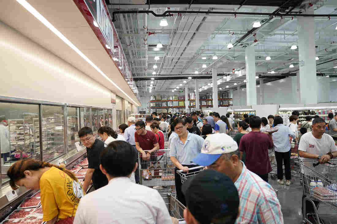 Costco saw large crowds as it opened its first store in mainland China on Tuesday.                          Aly Song  Reuters                   hide caption