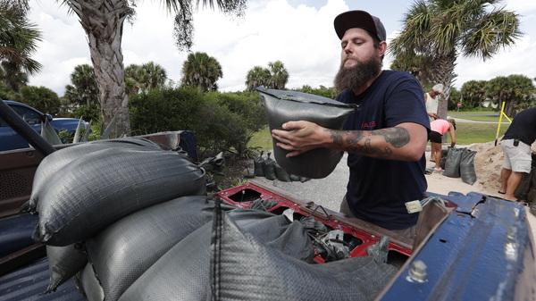 In Flagler Beach, Fla., Matt Rohrer gets sandbags on Friday to take home to prepare for Hurricane Dorian.