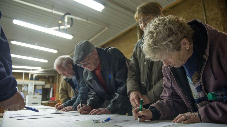 Participants sign in at a Democratic Party caucus at Jackson Township Fire Station in Keokuk, Iowa, on Feb. 1, 2016. The DNC has scrapped a virtual caucus plan for 2020. (Michael B. Thomas/AFP/Getty Images)