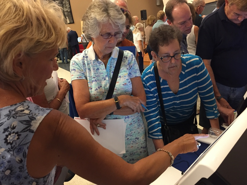 Attendees in Bucks County, Pa. test-drove new voting machines at an event aimed at helping the county decide which equipment to buy. Security is a major focus in the 2020 presidential race. (Pam Fessler/NPR)