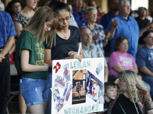 High School students Celeste Lujan, left, and Yasmin Natera mourn their friend, Leila Hernandez, one of the victims of the Saturday shooting in Odessa, Texas, at a memorial service on Sunday.