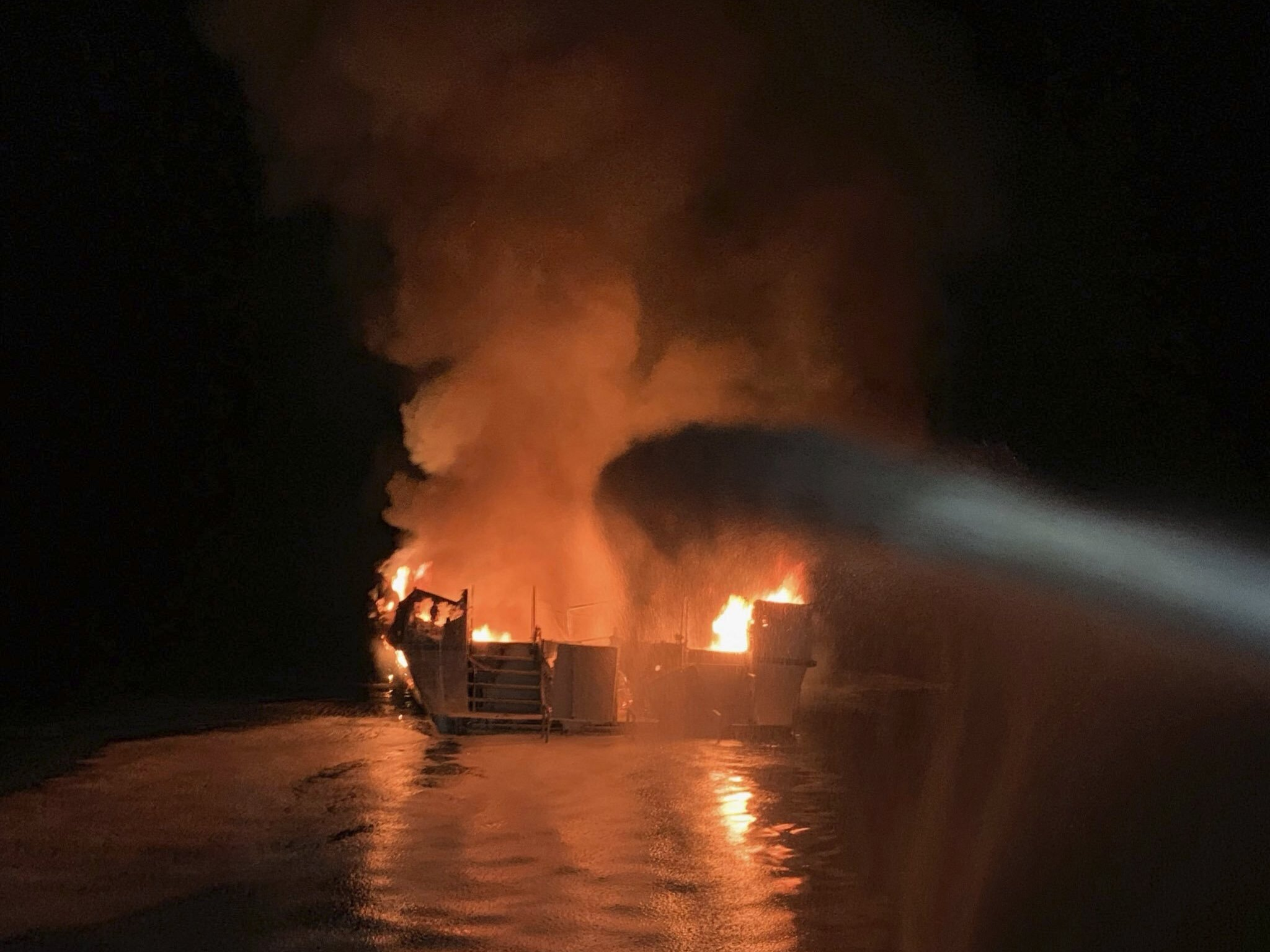 Ventura County Fire Department firefighters respond to a boat fire off the Southern California coast on Monday