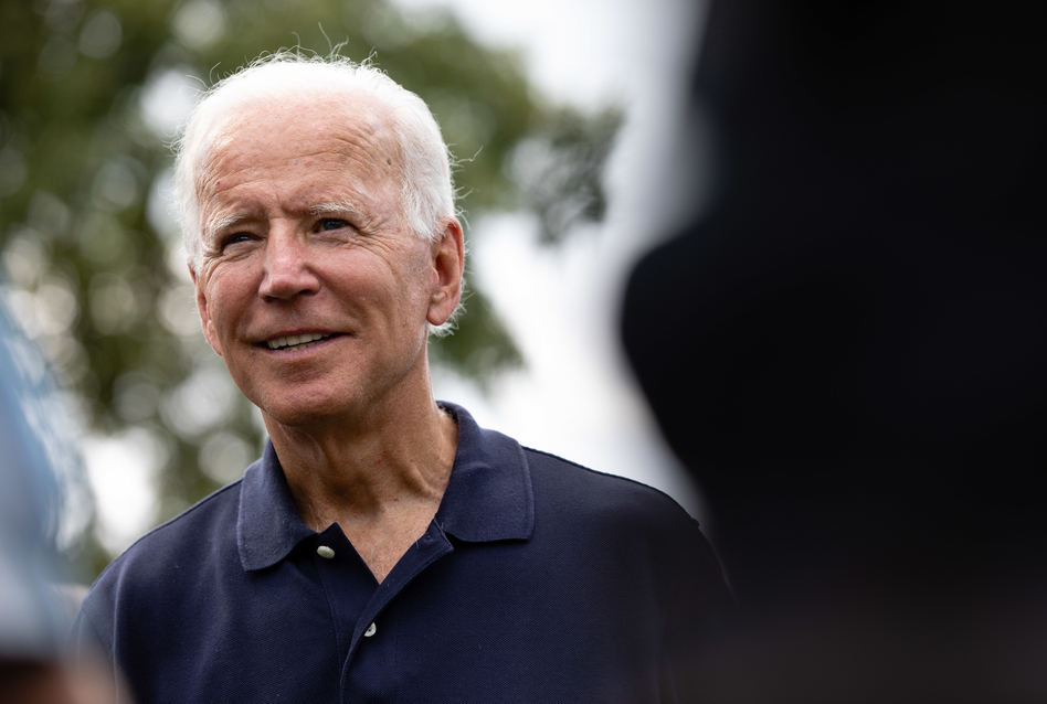 Former Vice President Joe Biden takes photos and meets with voters as he campaigns Monday, Sept. 2, 2019, during the Iowa City Federation of Labor Labor Day Picnic at City Park in Iowa City, Iowa. Scott Morgan for NPR (Scott Morgan for NPR)
