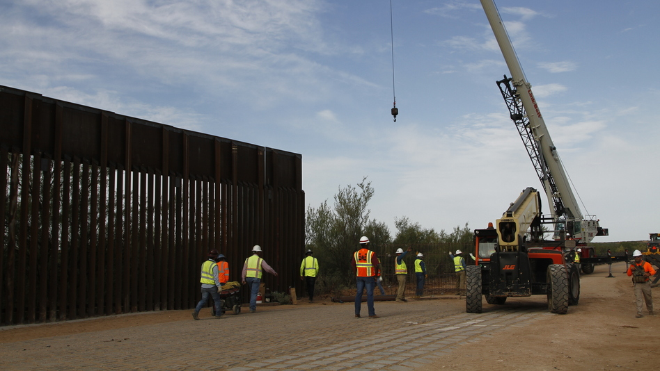 Workers break ground on new border wall construction about 20 miles west of Santa Teresa, N.M., last month. The Trump administration has started the arduous process of canceling $3.6 billion in military construction projects to fund its plans to build more of a wall along the U.S.-Mexico border. (Cedar Attanasio/AP)