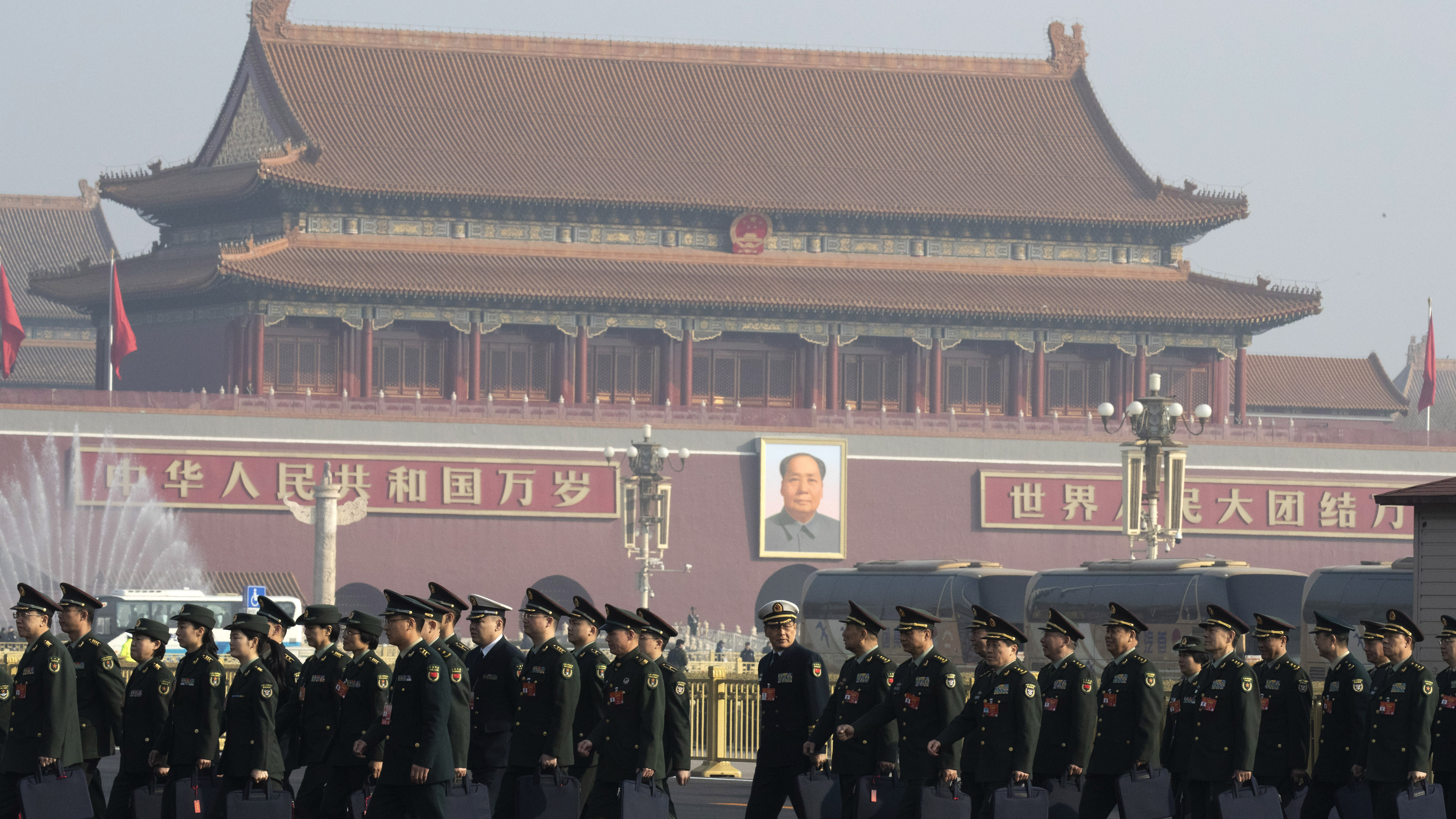 Chinese military delegates arrive for the National People's Congress in Beijing last March. The growing friction between the U.S. and China, combined with the rapid rise of China's economy and its military, has stirred a debate about whether the U.S. and China are headed toward a Cold War.