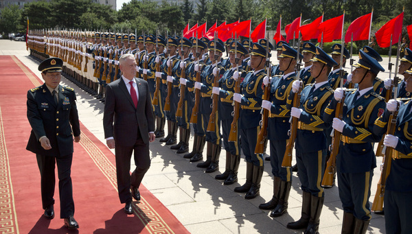 China's Defense Minister Wei Fenghe (left), and then-U.S. Defense Secretary Jim Mattis review an honor guard in Beijing in June 2018. Despite the increasing rivalry between the two countries, they still have top-level military contacts.
