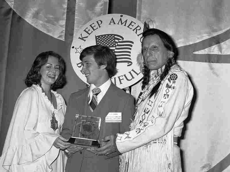Iron Eyes Cody presents the first place Keep America Beautiful award to Leland C. Barbeur, President of the Fayetteville, N.C., County Youth Council, in 1975.