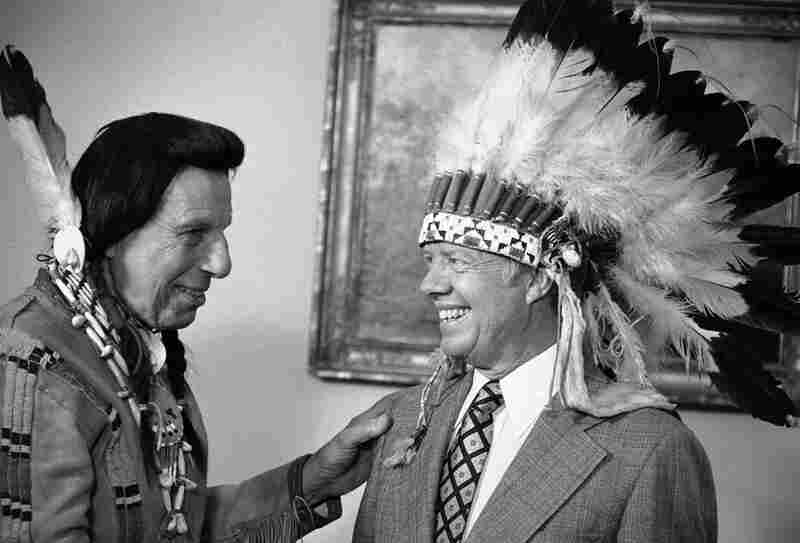 Iron Eyes Cody presents President Jimmy Carter with a Native American headdress in the Oval Office on April 21, 1978. Cody also gave Carter a Native American name, Wamblee Ska, which he said means great white eagle.