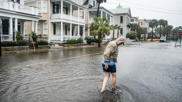 """Many of the streets in Charleston, S.C., were flooded Thursday under the heavy rains of Hurricane Dorian. The storm's eyewall remained offshore at least through early afternoon —€"""" but that hasn't saved the Carolinas from severe winds and flooding."""