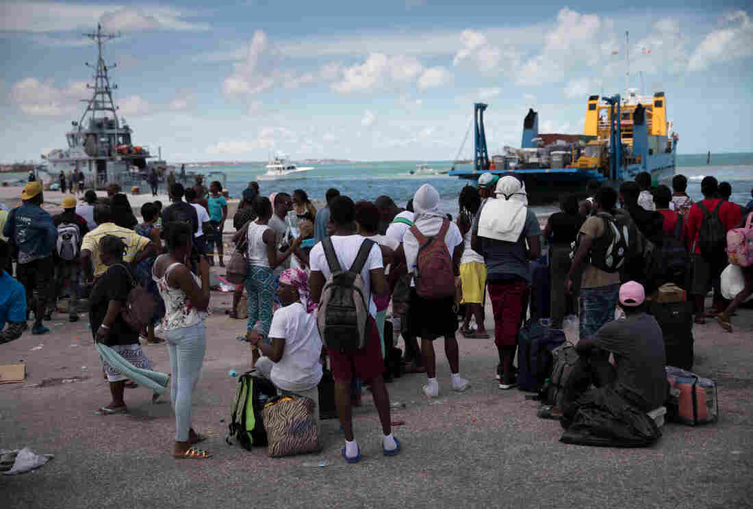 Several hundred desperate Haitians and Bahamanians wait at the port of Marsh Harbour in the hopes of boarding a boat to Nassau after the town was decimated by Hurricane Dorian on Abaco in the Bahamas.