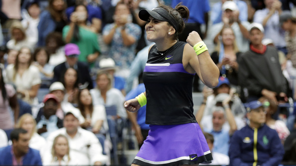 Bianca Andreescu reacts after defeating Serena Williams in the women