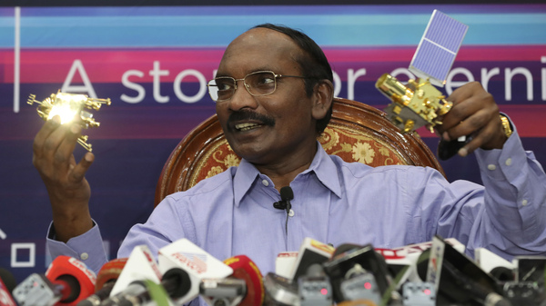 Indian Space Research Organization (ISRO) Chairman Kailasavadivoo Sivan displays a model of Chandrayaan 2 orbiter and rover during a press conference at their headquarters in Bangalore, India onAug. 20.