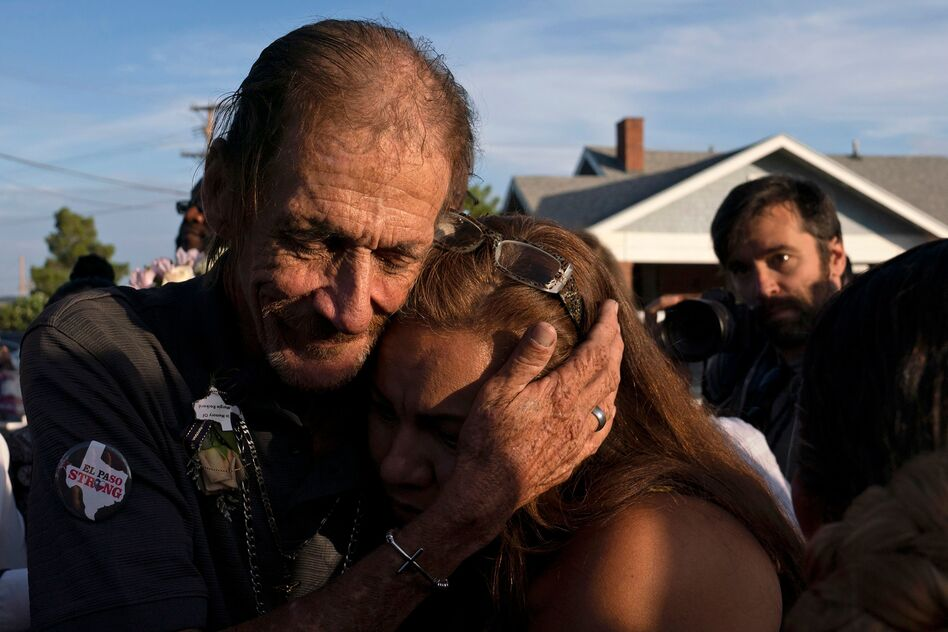 Antonio Basco, husband of El Paso Walmart shooting victim Margie Reckard, hugs an attendee during his wife's visitation service in El Paso, Texas, in August. (Paul Ratje/AFP/Getty Images)