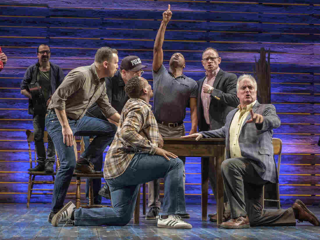"""The cast of """"Come from Away"""" perform at the Phoenix Theatre in London."""
