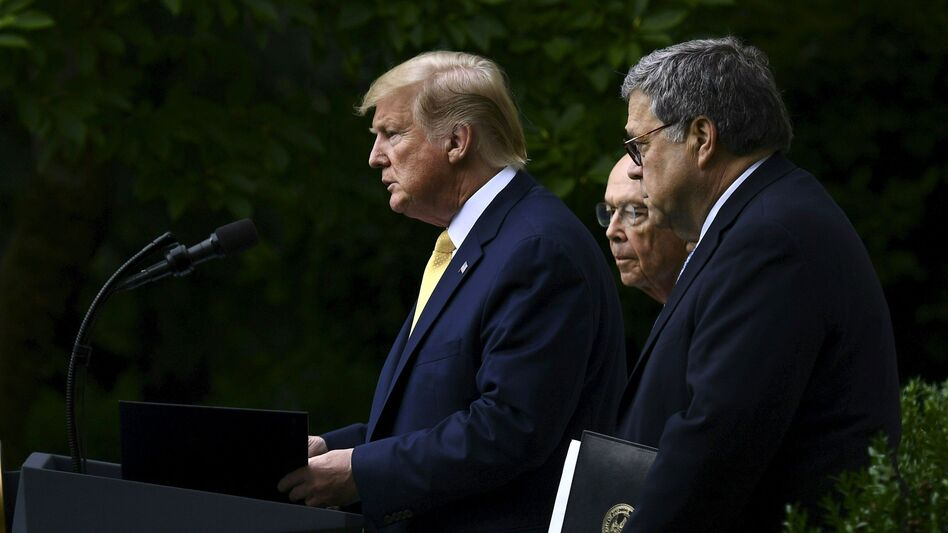 President Trump, flanked by Commerce Secretary Wilbur Ross (back) and U.S. Attorney General William Barr, delivers remarks on citizenship data in the Rose Garden at the White House in Washington, D.C., in July. (Brendan Smialowski/AFP/Getty Images)