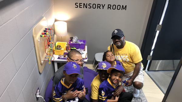 Sheletta and Shawn Brundidge, alongside their four children, were the first fans to use the sensory room at the Minnesota Vikings