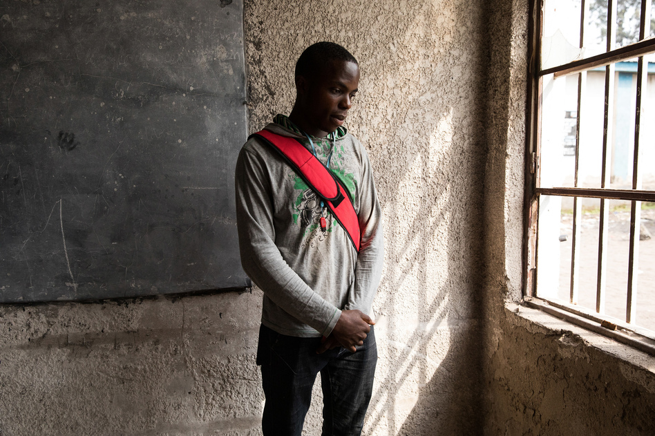 Samuel Swedi, 22, is an electrical engineering student at Goma University in the Democratic Republic of Congo. He doesn't have a textbook — just whatever notes he has written in his notebook. (Samantha Reinders for NPR)