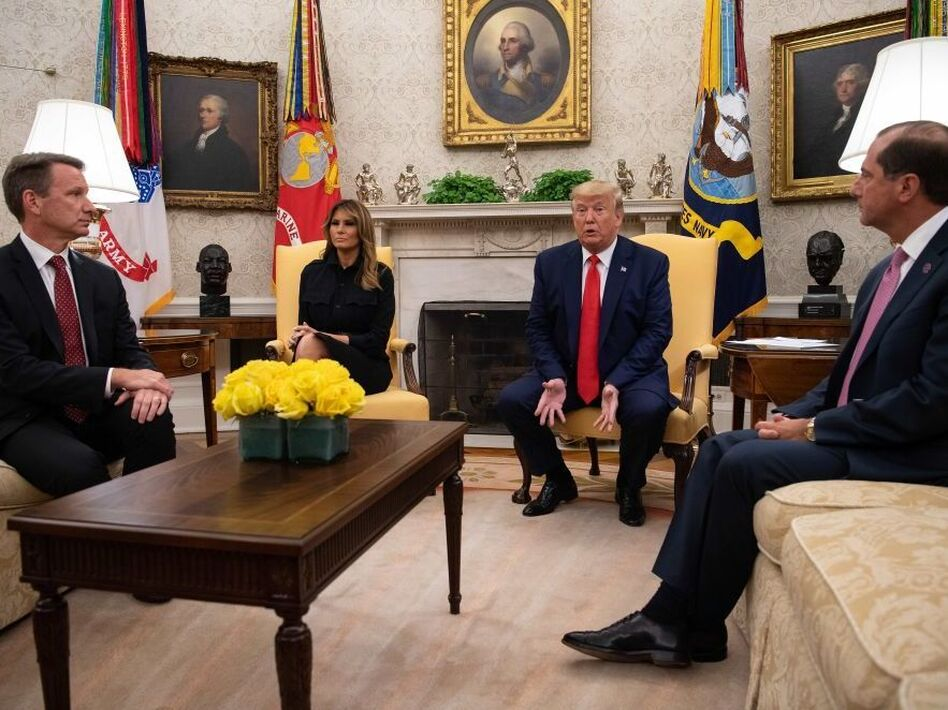 President Trump speaks to the press with first lady Melania Trump and Acting Food and Drug Administration Commissioner Norman Sharpless (left) and Health and Human Services Secretary Alex Azar in the Oval Office at the White House on Wednesday. (Nicholas Kamm/AFP/Getty Images)