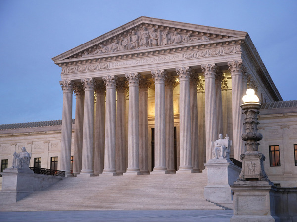 The U.S. Supreme Court building at dusk on Capitol Hill in Washington.