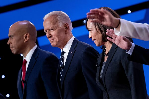 Democratic presidential hopefuls, from left to right: Sen. Cory Booker, D-N.J., former Vice President Joe Biden, and Sen. Kamala Harris, D-Calif., on stage for the second round of primary debates.
