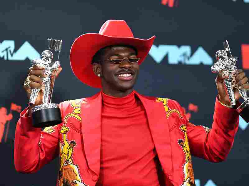 """Rapper Lil Nas X poses with the Song of the Year Award in the press room during the 2019 MTV Video Music Awards. Lil Nas X's song """"Old Town Road"""" was initially removed from Billboard's Hot Country Songs list which sparked controversy among fans."""