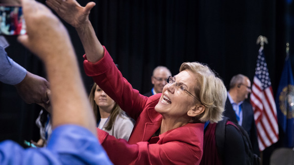 Democratic presidential candidate Sen. Elizabeth Warren shakes hands with supporters after speaking at the New Hampshire Democratic Party Convention in Manchester, N.H., last week.