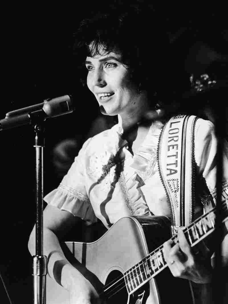 American country music singer and guitarist Loretta Lynn performs on stage at the Grand Ole Opry, 1960s.