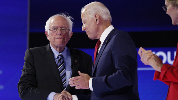 Sen. Bernie Sanders shakes hands with former Vice President Joe Biden Thursday.