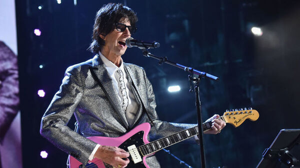 Ric Ocasek of The Cars, performing at the group