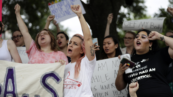 A group gathers at the state capitol in Austin, Texas, in May to protest abortion restrictions. In defiance of the state