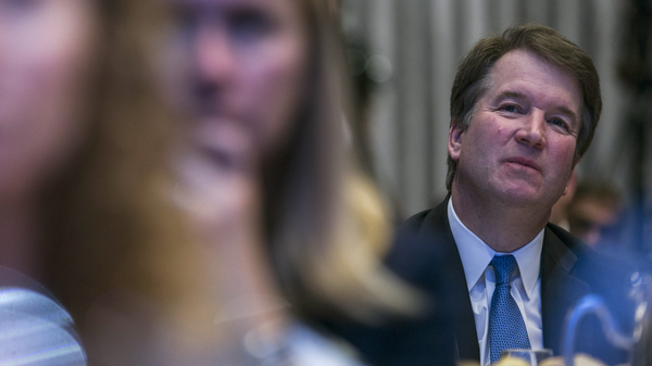 Supreme Court Justice Brett Kavanaugh listens to a discussion at a Washington event. The justice is facing a new allegation of sexual misconduct, leading some Democrats to call for his impeachment.