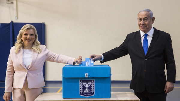Israeli Prime Minister Benjamin Netanyahu and his wife, Sara, cast their votes at a voting station in Jerusalem on Tuesday.