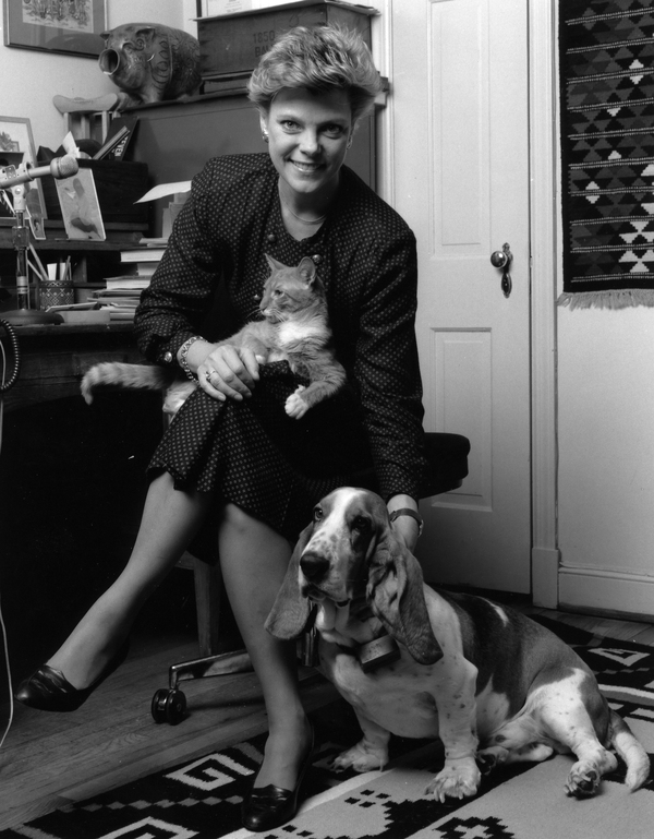 Roberts is shown in her home office in 1990 with her dog, Abner, and cat, Tabasco.